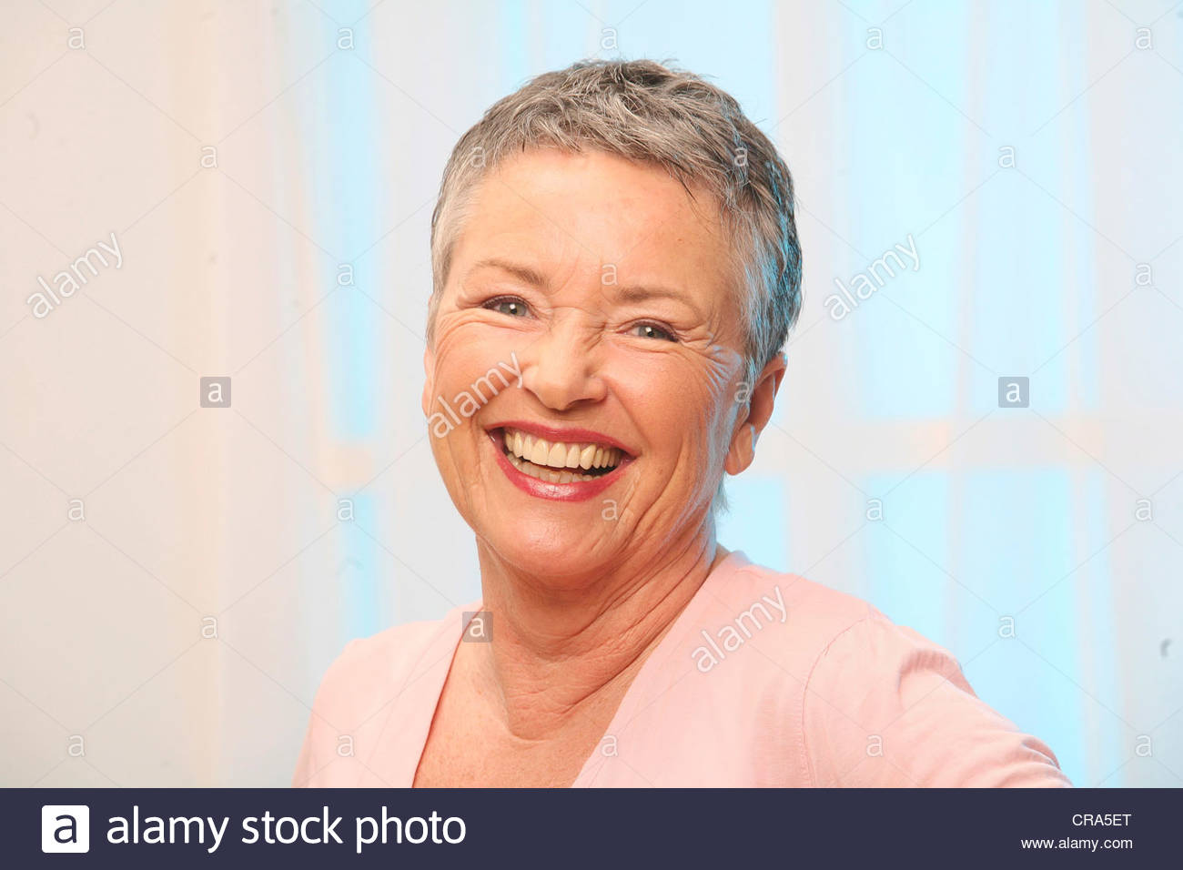 Portrait Of Older Woman With Short Grey Hair Smiling At