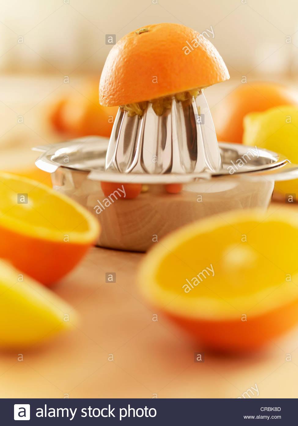 Oranges and juicer Stock Foto