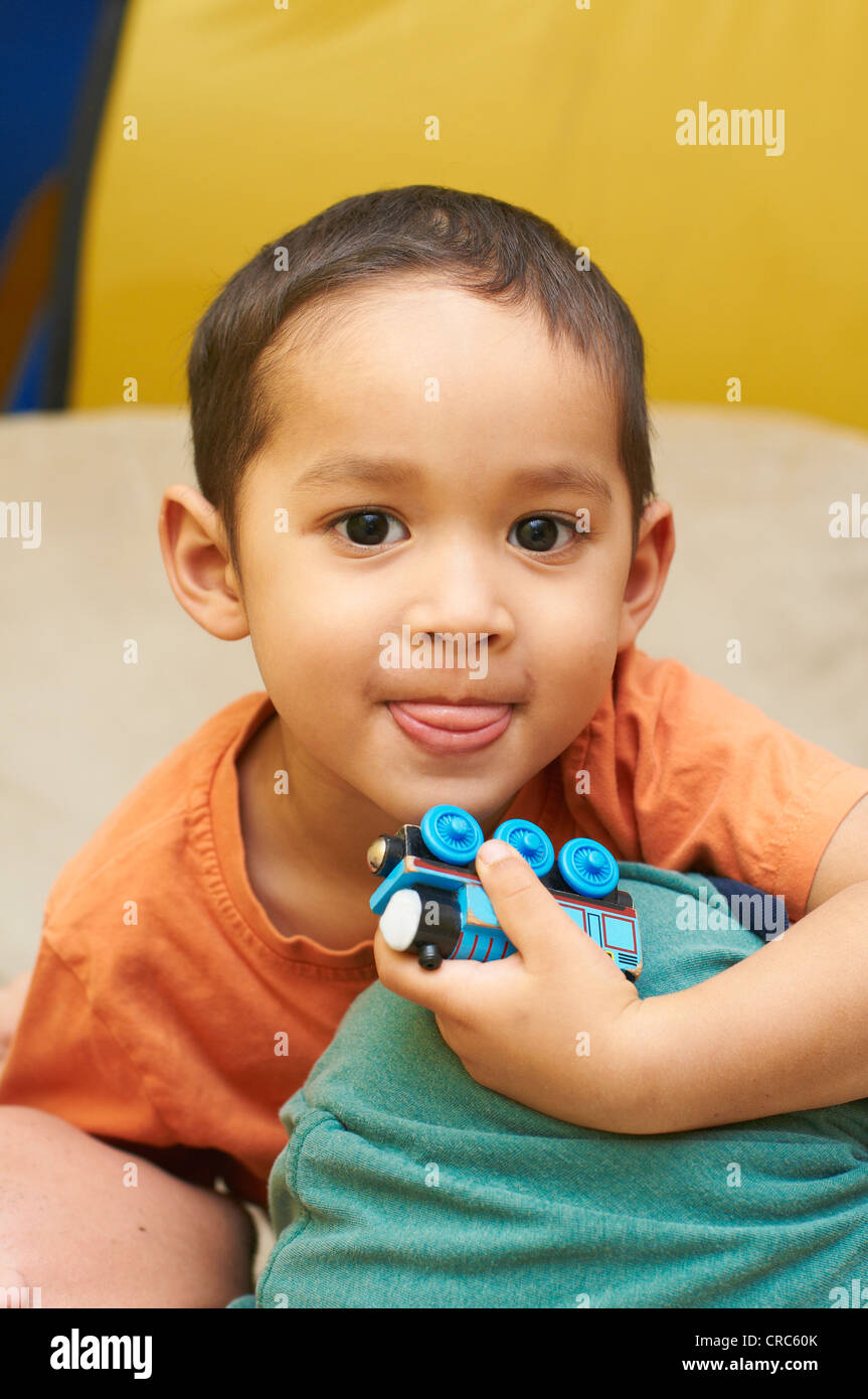 Boy playing with toy train Stock Photo