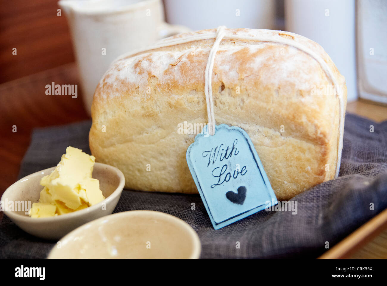 Loaf of bread with butter on cloth Stock Foto