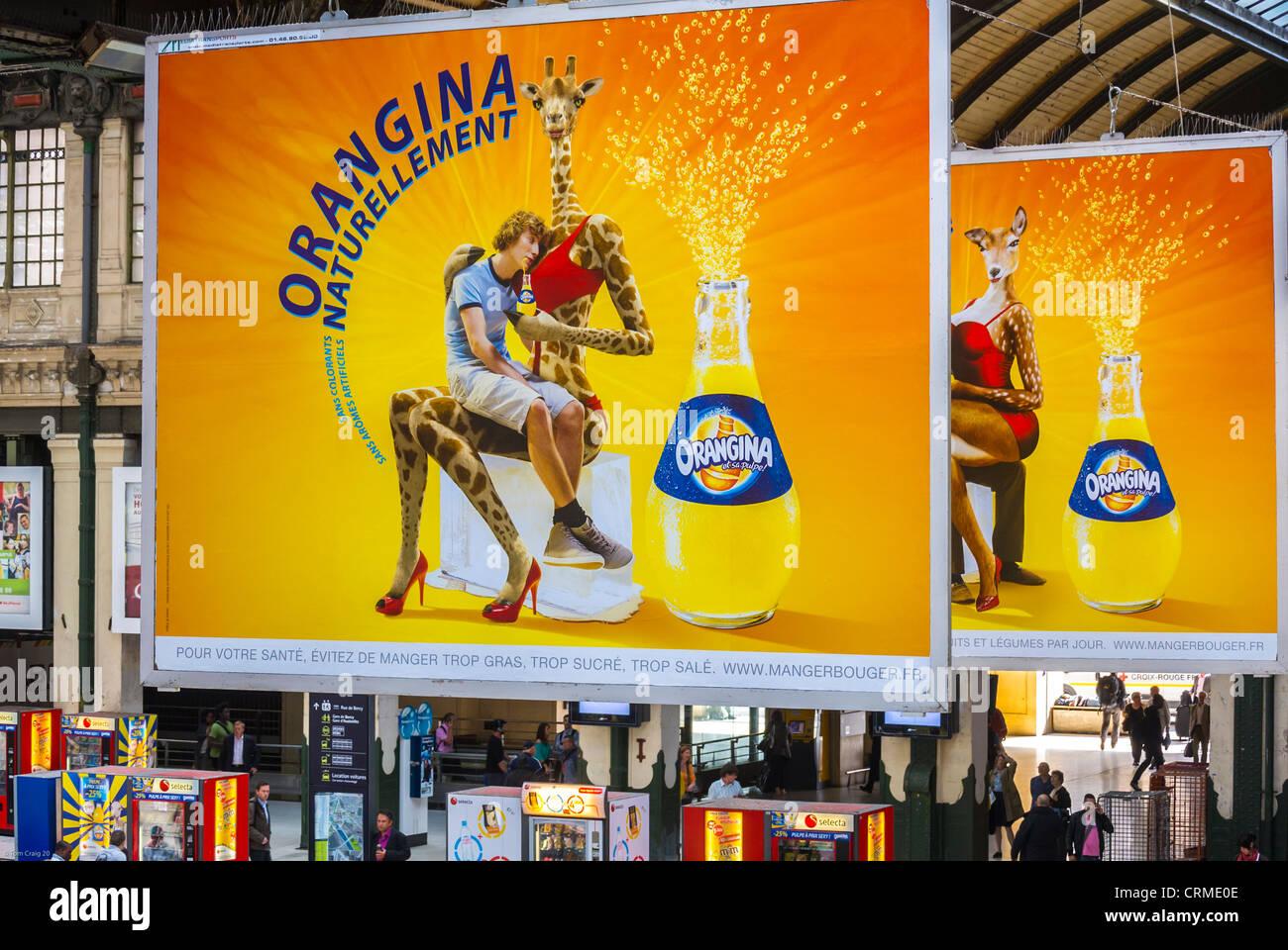 "Paris, France, French Soft drink (""orangina"") Advertising Billboards on display inside Train Station, ""Gare de Lyon"", Stock Photo"