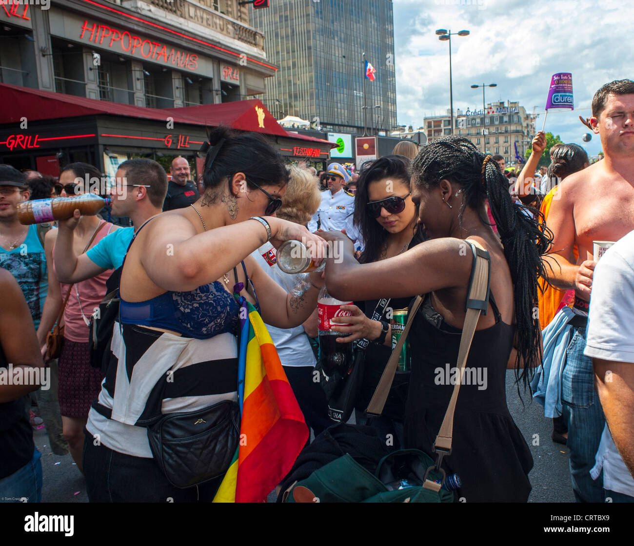 Paris, France, French Female Teenagers Binge Drinking Pouring Alcohol into Soft Drink Soda Bottles on  Sidewalk, Stock Photo