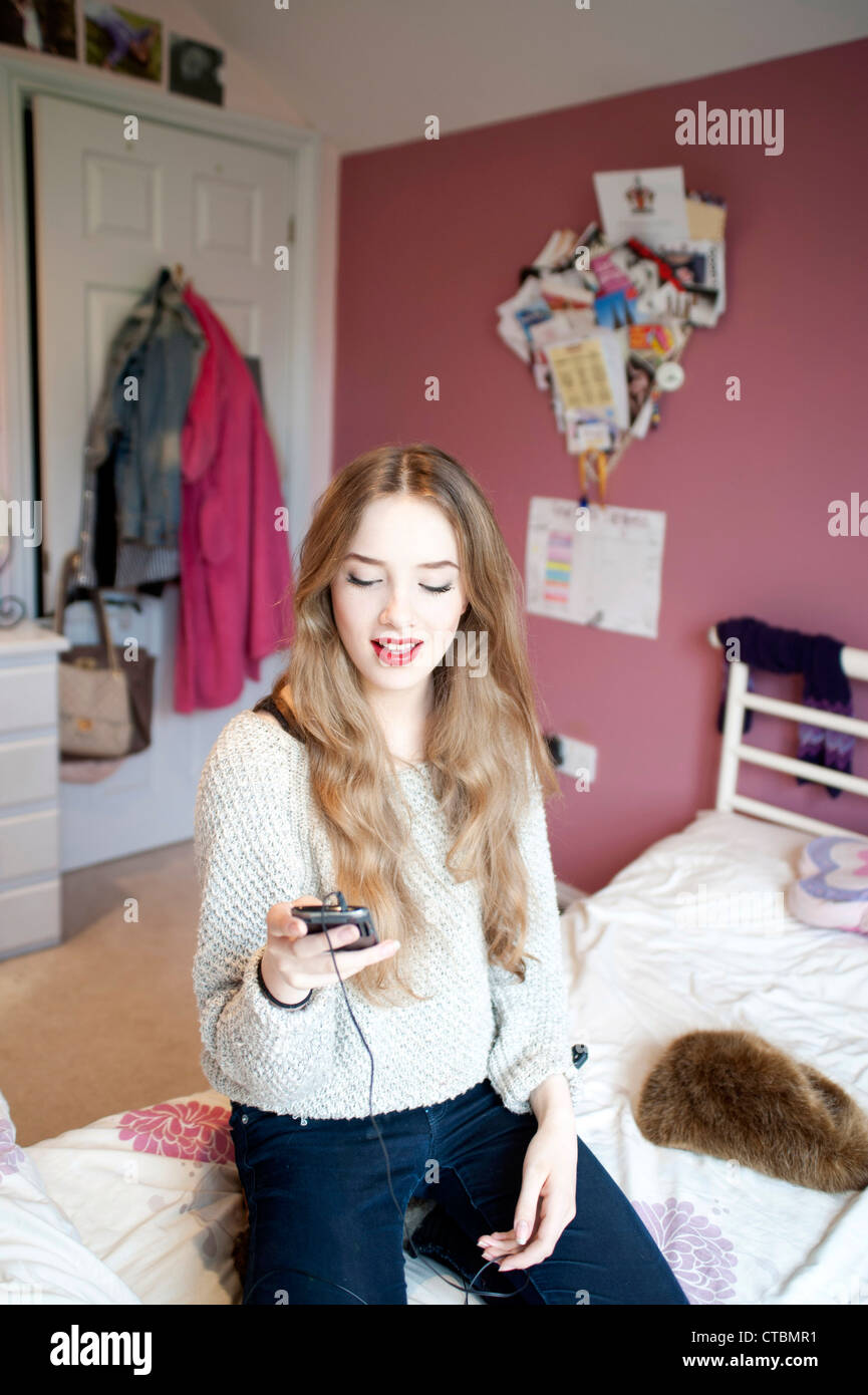 Young 15 year old blond girl in teenage bedroom stock for 15 year old bedroom