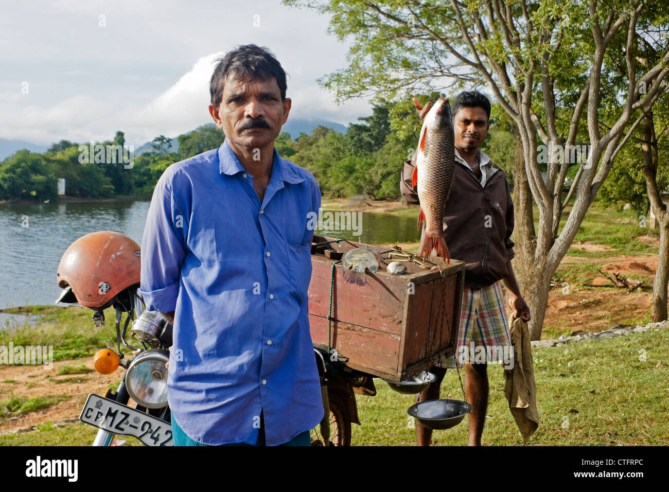 Men selling fish at Lake Kandalama, Sri Lanka Stock Photo