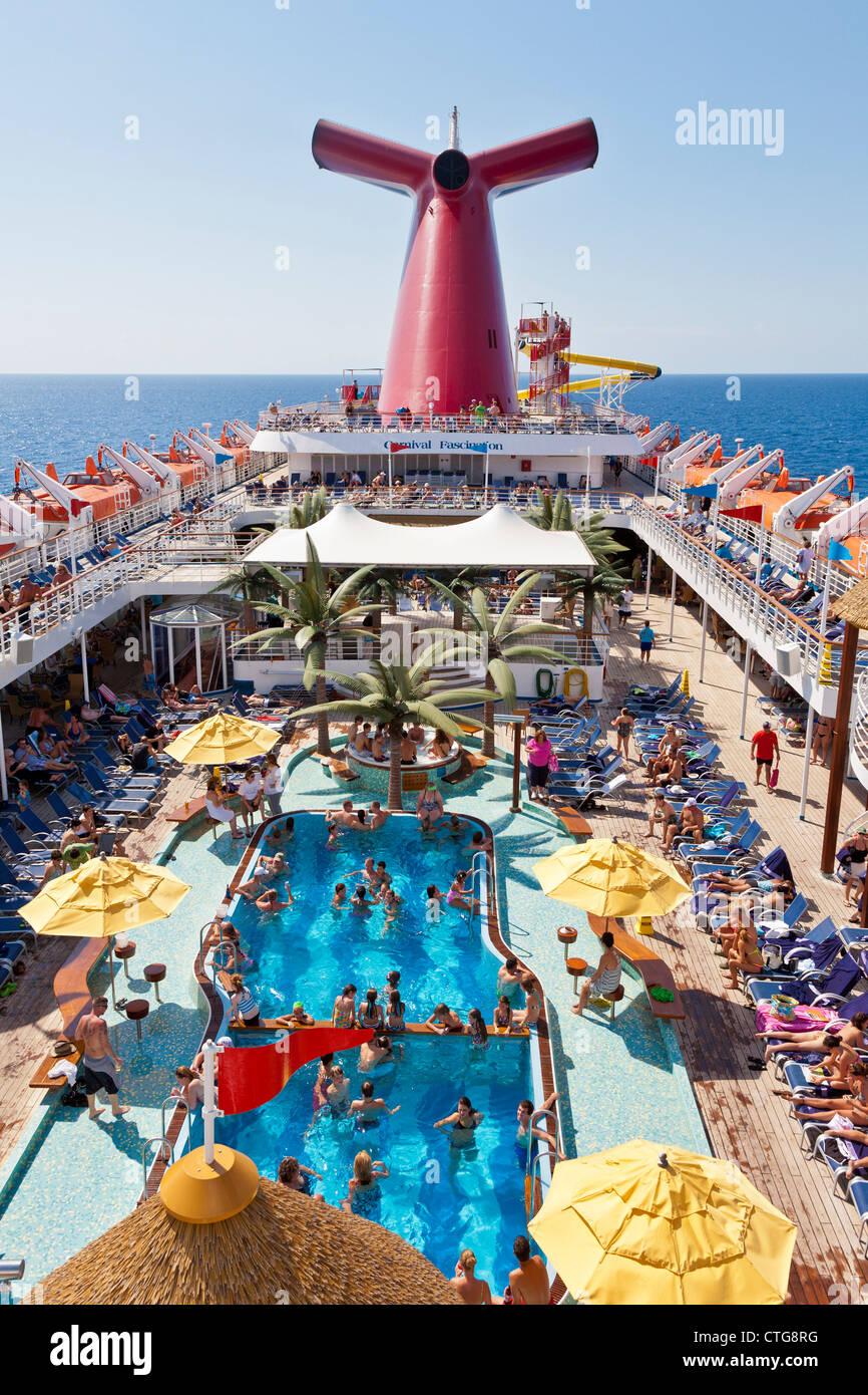 Cruise Passengers Enjoying The Sun On Deck Of Carnival