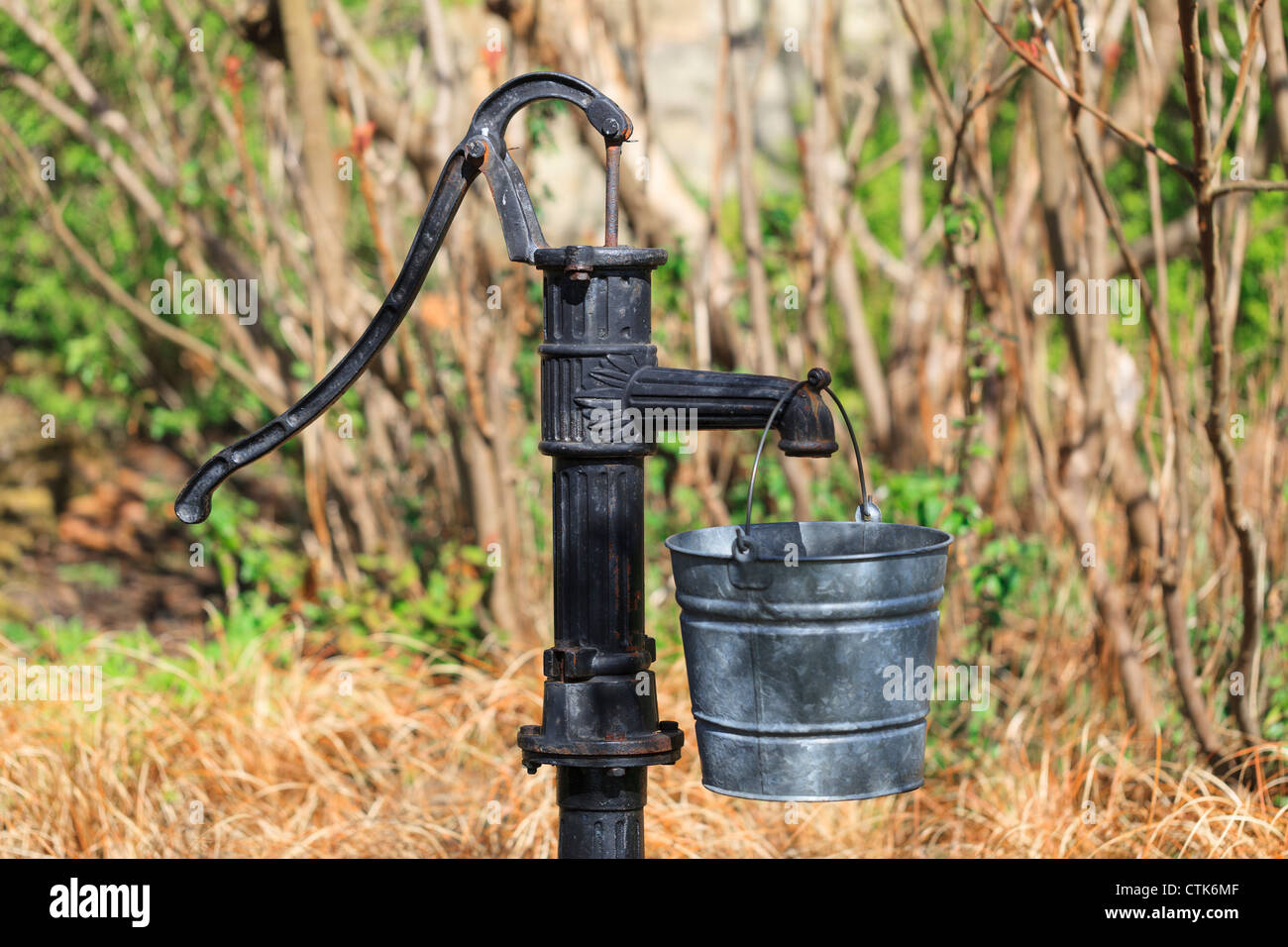 Old Water Pump And Metal Bucket Stock Photo Royalty Free