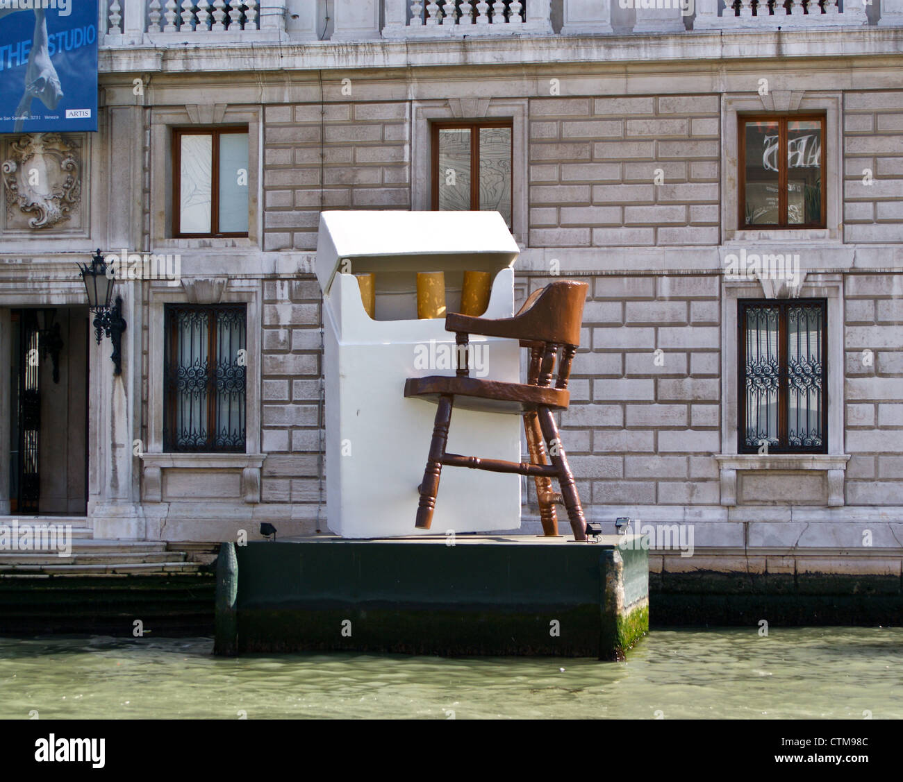 a-sculpture-of-an-outsized-chair-and-pac