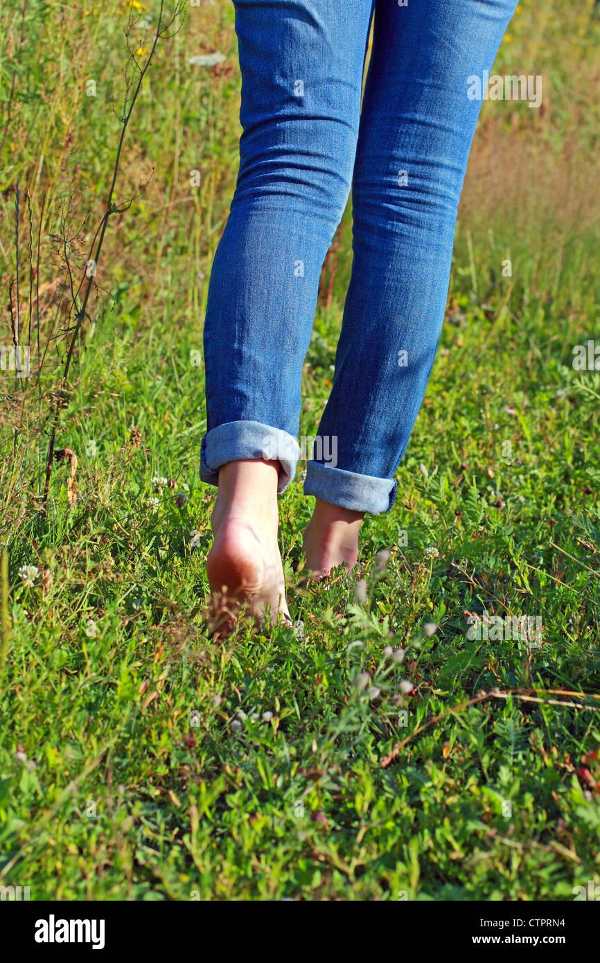 woman walking in grass - photo #25