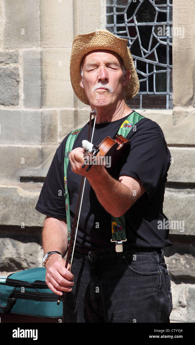 folk-musician-playing-the-fiddle-at-durh
