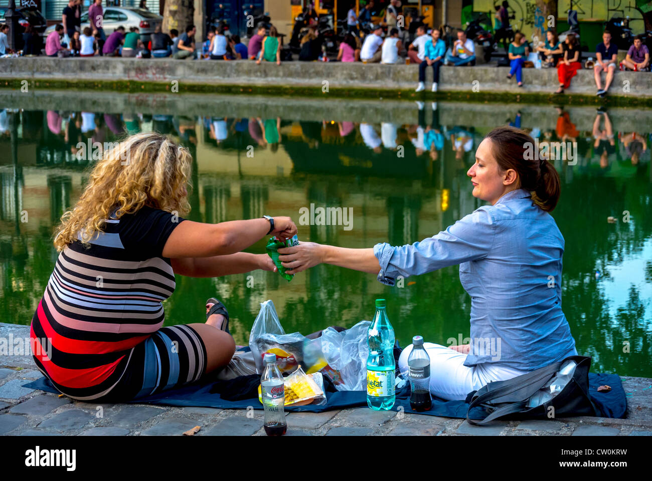 "Paris, France, French Women Picnicking, Sharing Drinks Outside,  on the ""Canal Saint Martin"" Stock Photo"