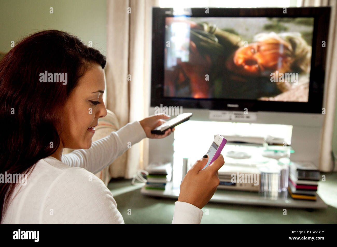 a-young-woman-watching-tv-using-a-remote