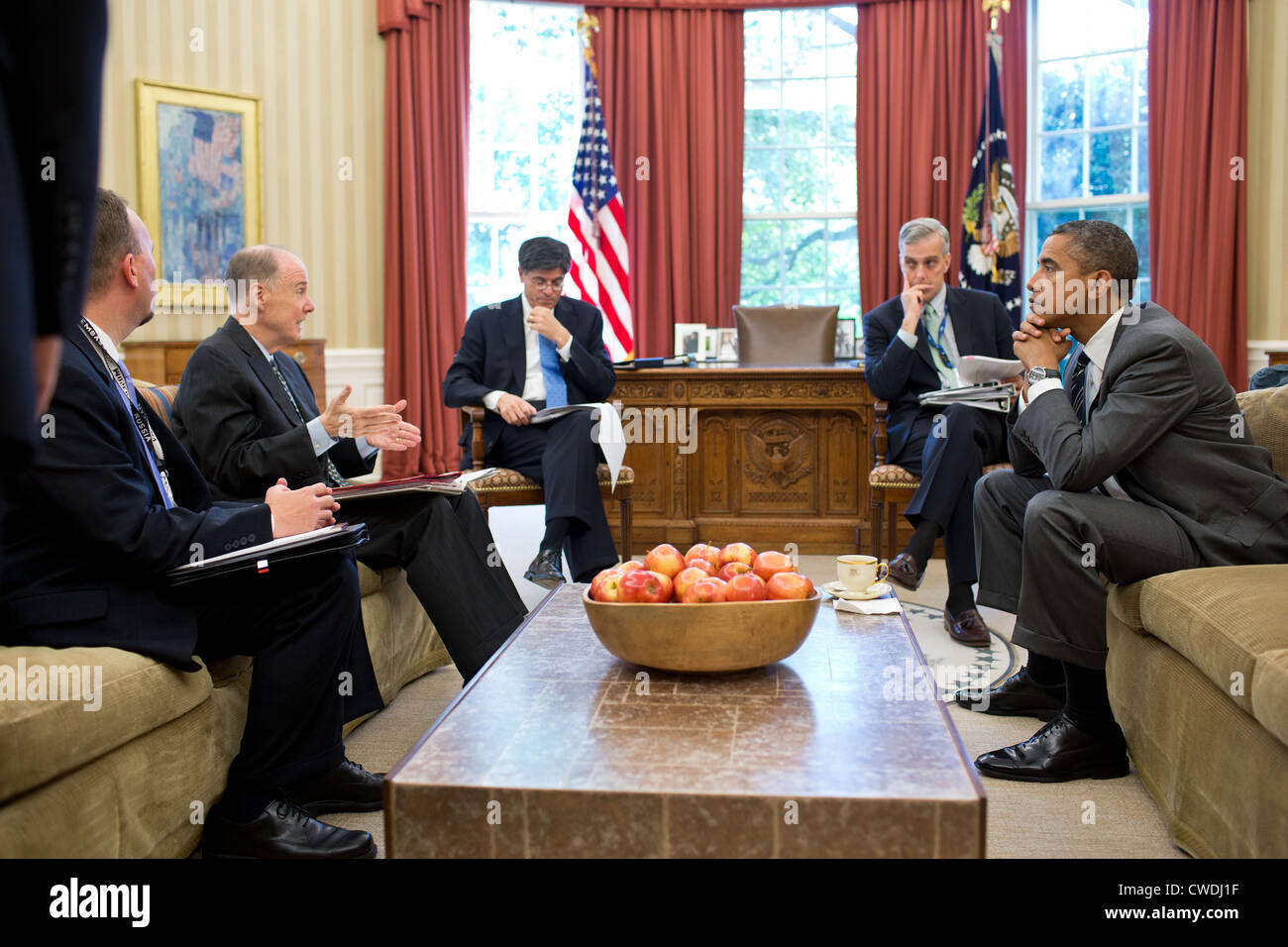 President Barack Obama meets with senior advisors in the Oval Office before a phone call with President Vladimir Stock Photo