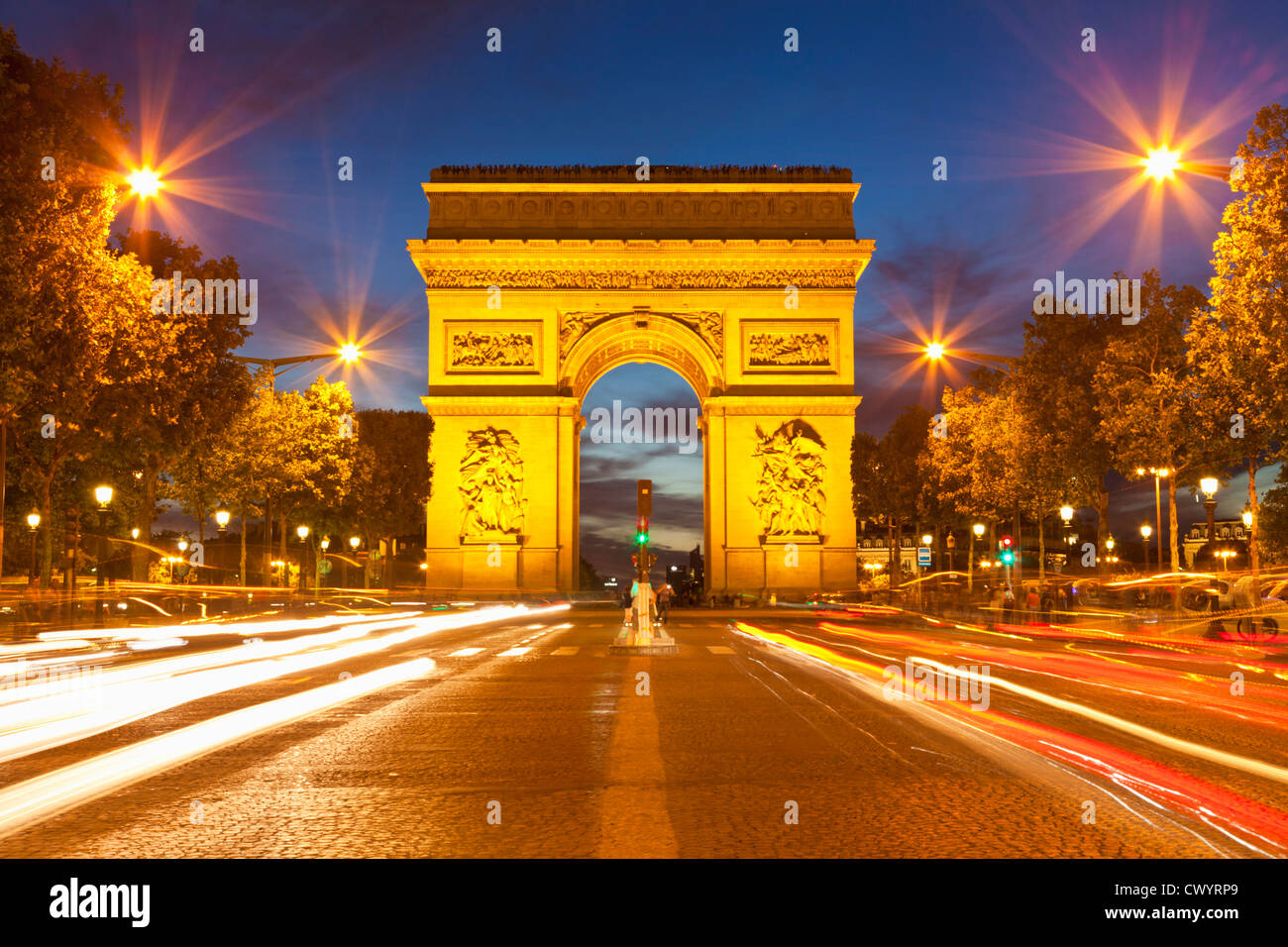 Arc Du Triomphe And Champs Elysees Traffic Light Trails At Night Stock Photo, Royalty Free Image ...