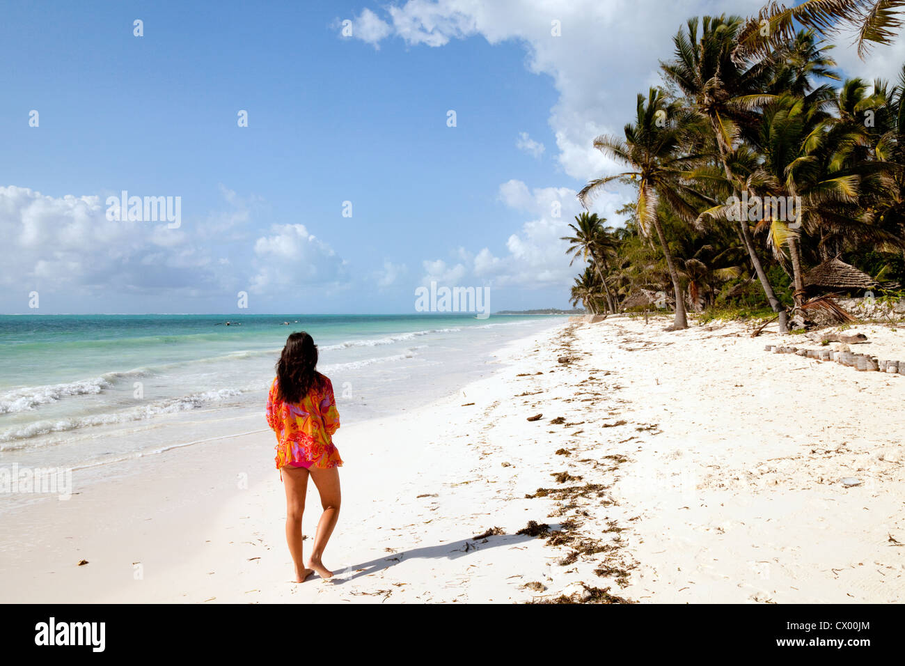 young-woman-walking-on-bwejuu-beach-zanz