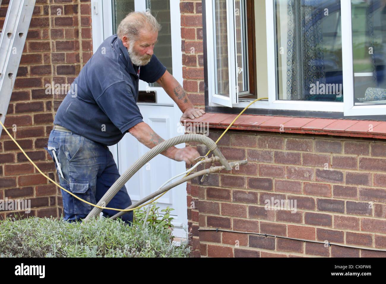 Workman Pumping Polystyrene Bead Cavity Wall Insulation