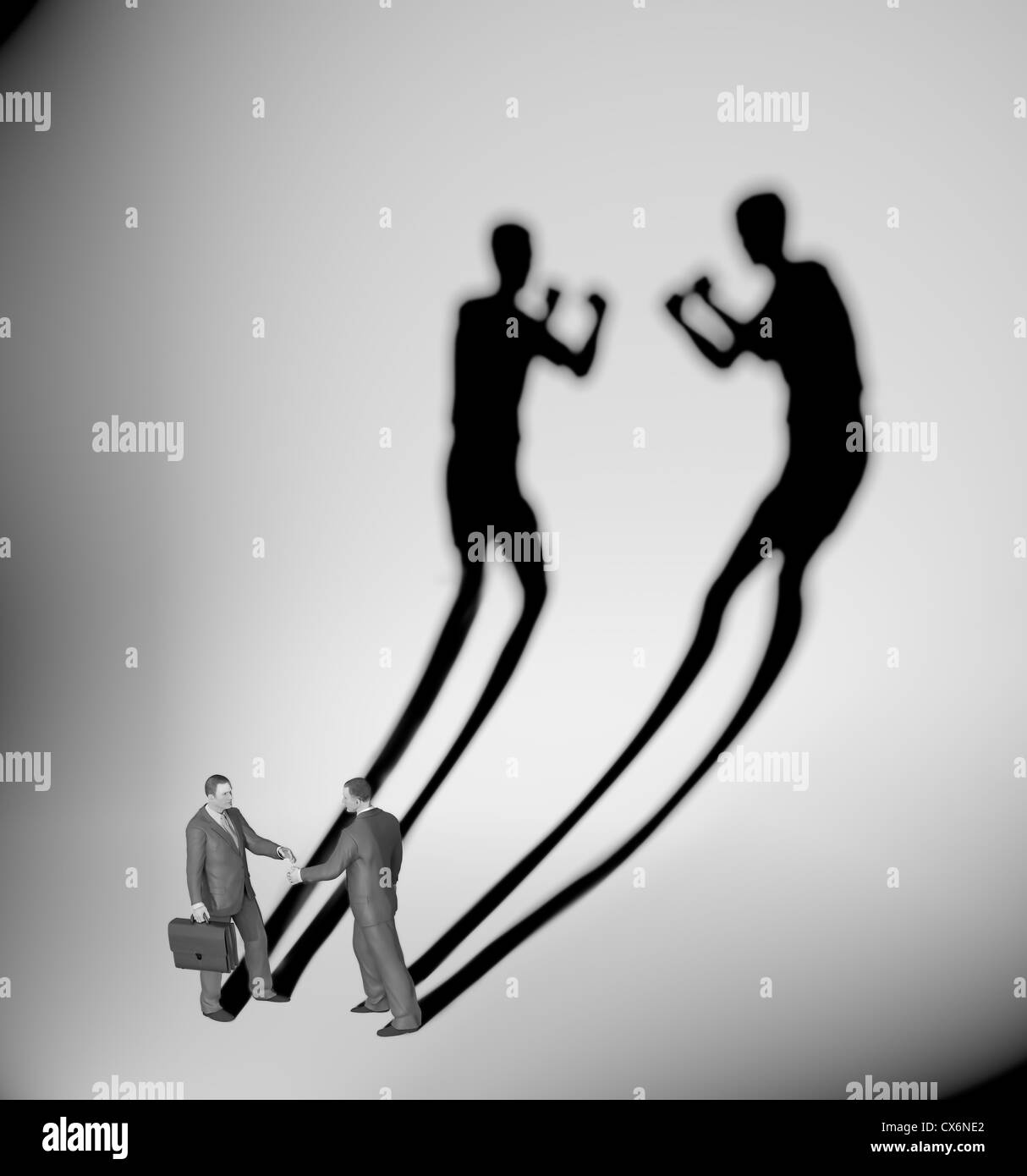 Two businessman casting a shadow shaped like two fighters Stock Foto