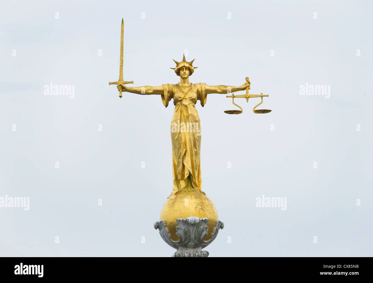 the gold bronze lady justice statue with sword and scales