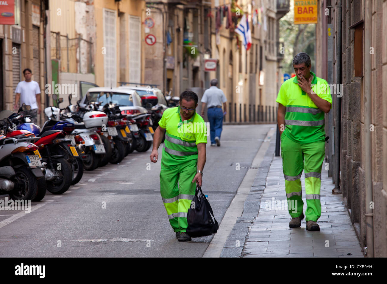 Two sanitation workers in barcelona are easily spotted