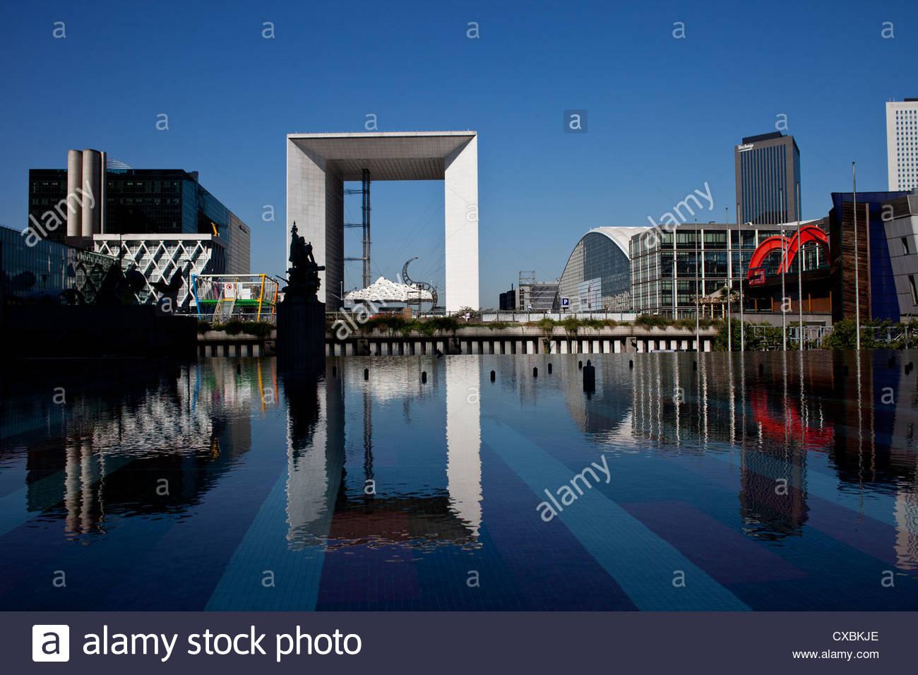 La Grande Arche reflected in a pool, La Défense, Paris. Stock Photo