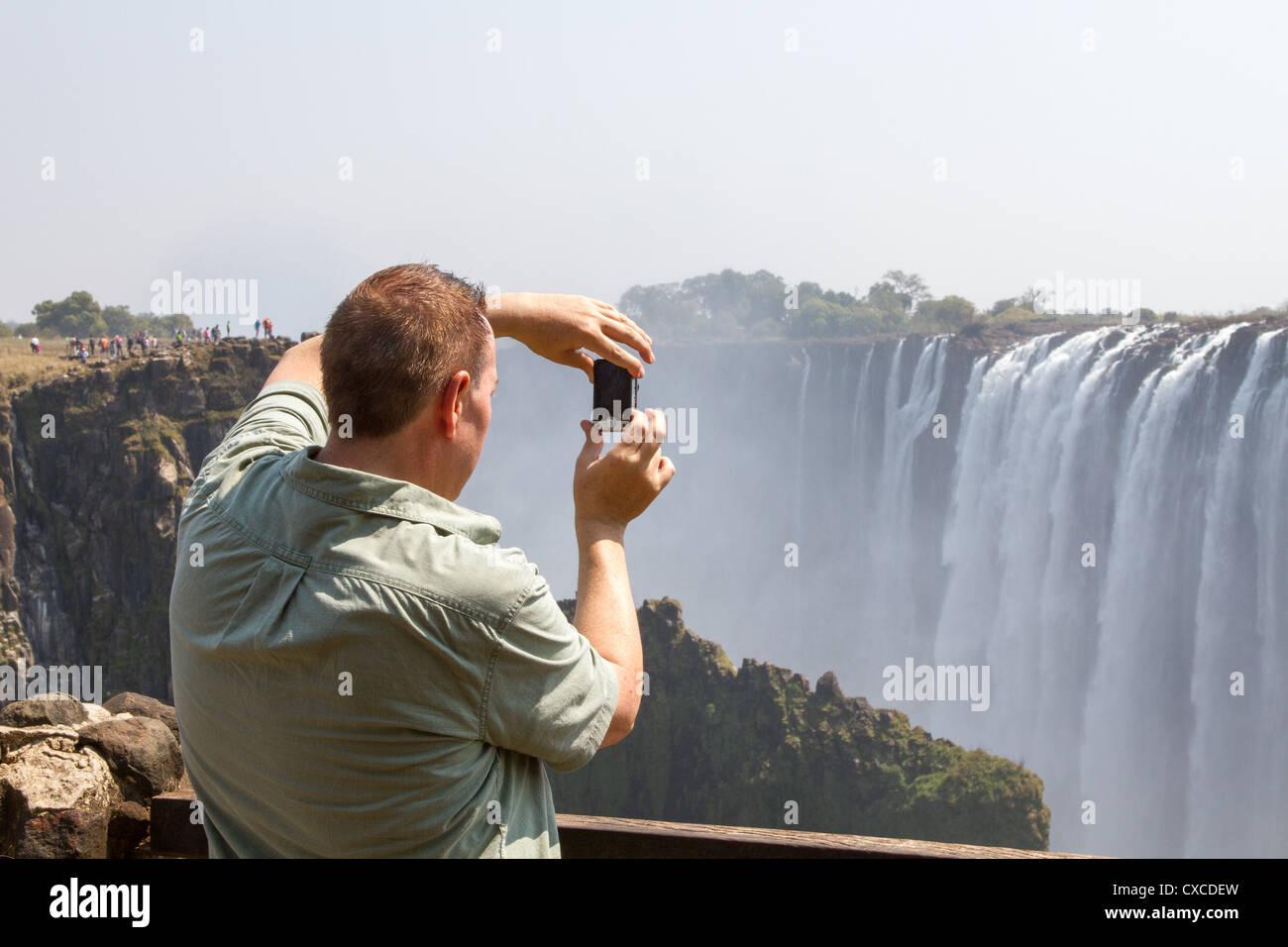 a-tourist-photographs-victoria-falls-fro