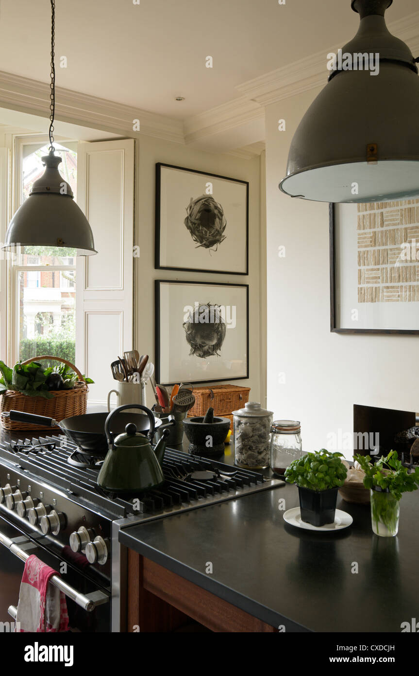 English Hob Kitchen ~ Kettle on hob of kitchen island with s grey pendant