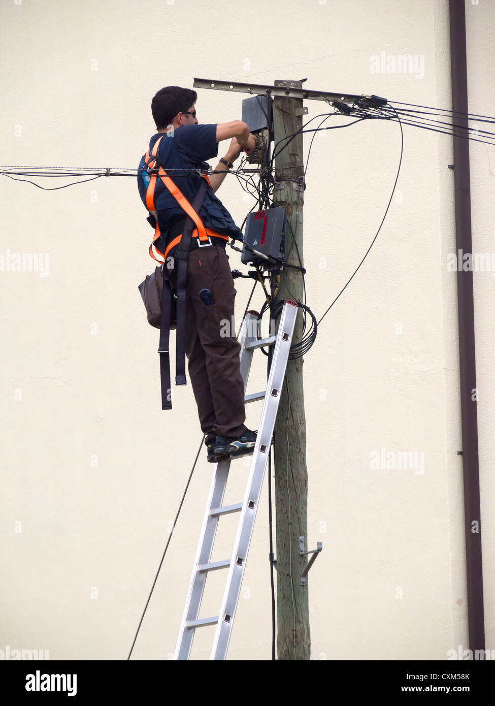 technician installing fiber optic broadband internet on a