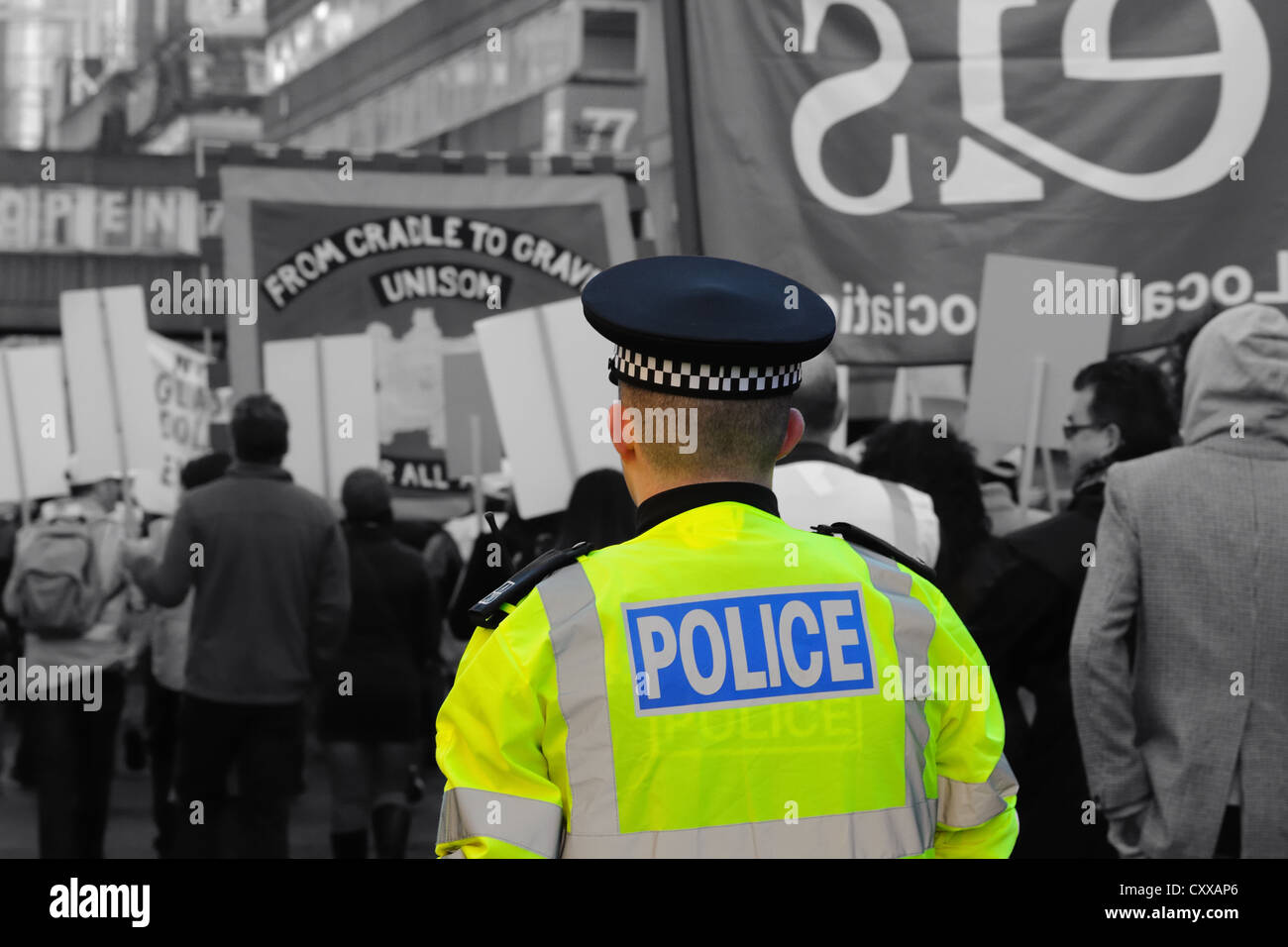 Scottish police constable supervising a political march. Selective colouring technique applied to hi viz jacket. Stock Photo