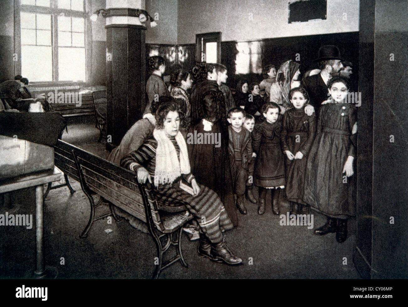 Group of Emigrants Waiting in the Detention Pen after Passing their Entrance Exam, Ellis Island, New York, USA, Stock Photo