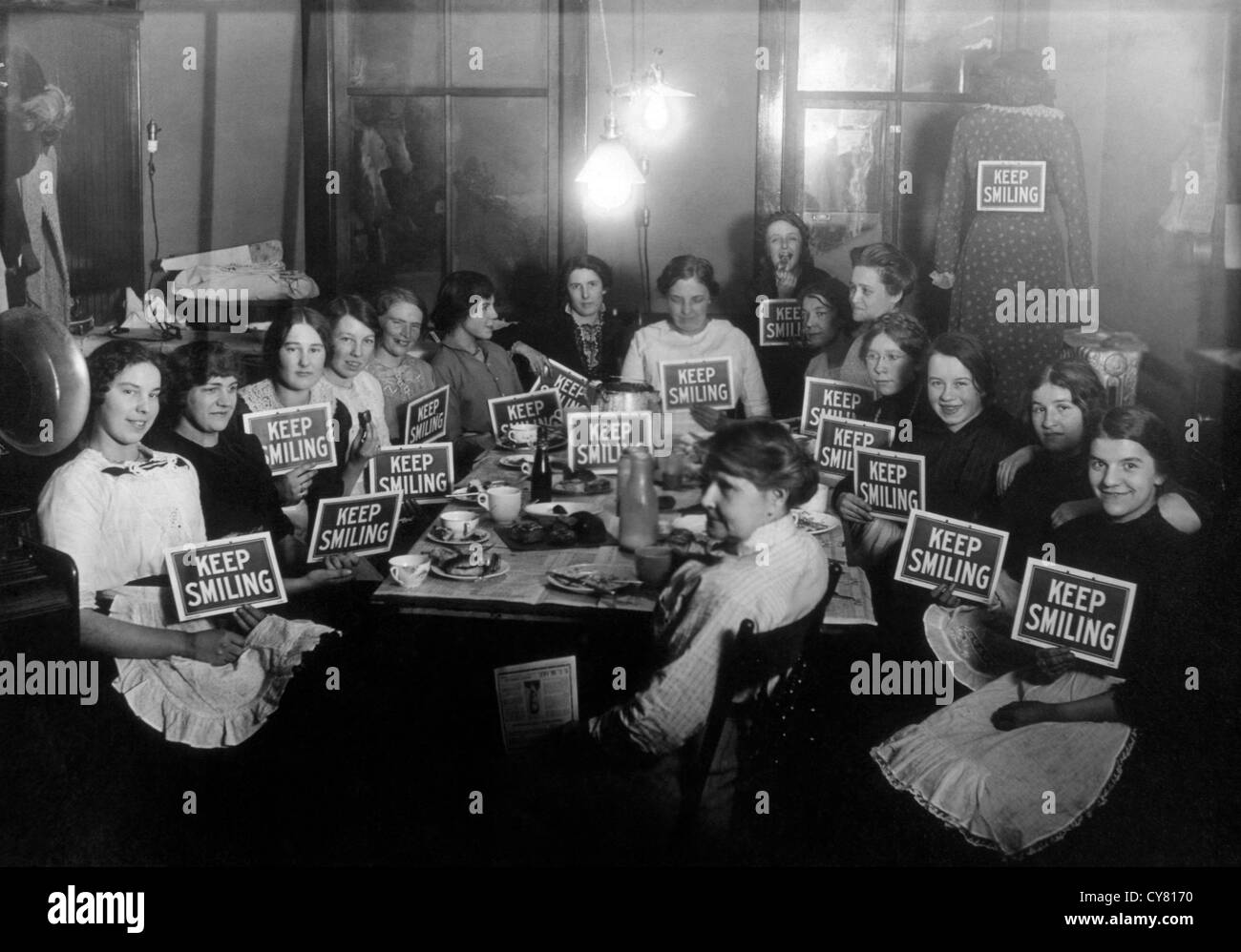 Seamstresses on Lunch Break, Holding Keep Smiling Signs, Circa 1914 Stock Photo