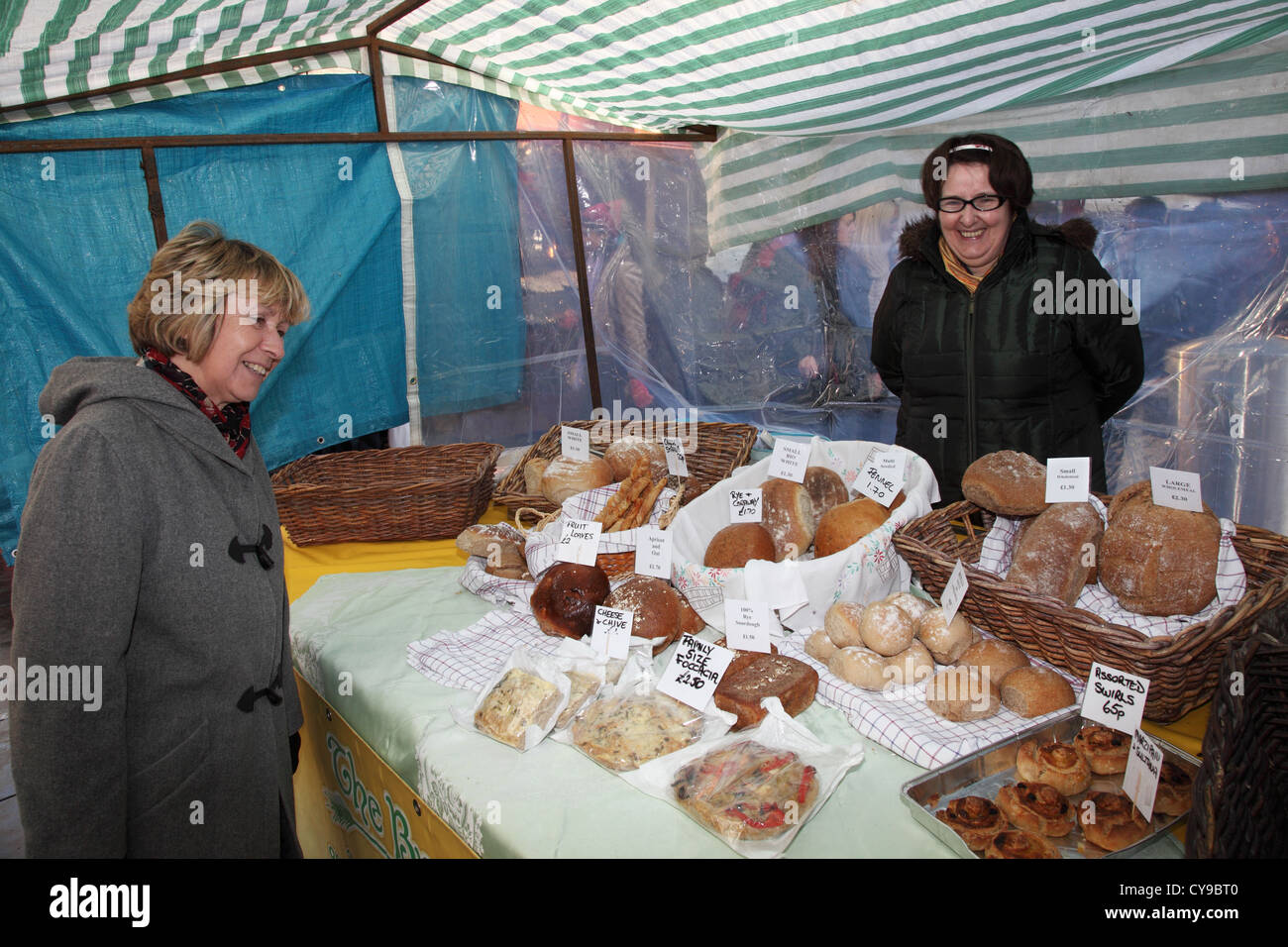 smiling-woman-stall-holder-and-female-cu