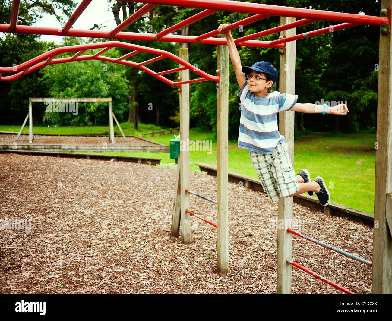 Confirm. swinging at the playground