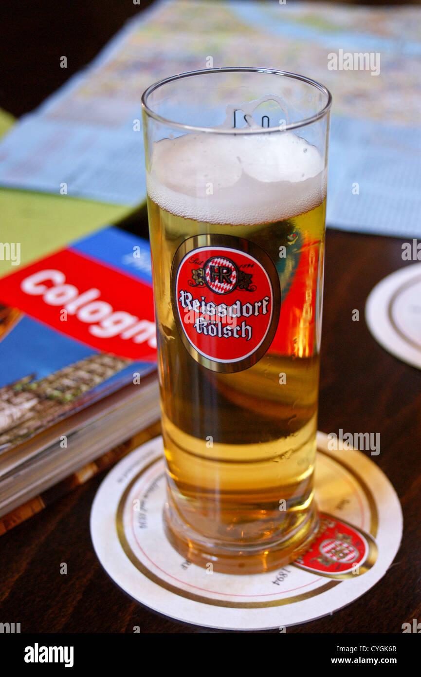 a-glass-of-reissdorf-klsch-ale-on-a-bar-