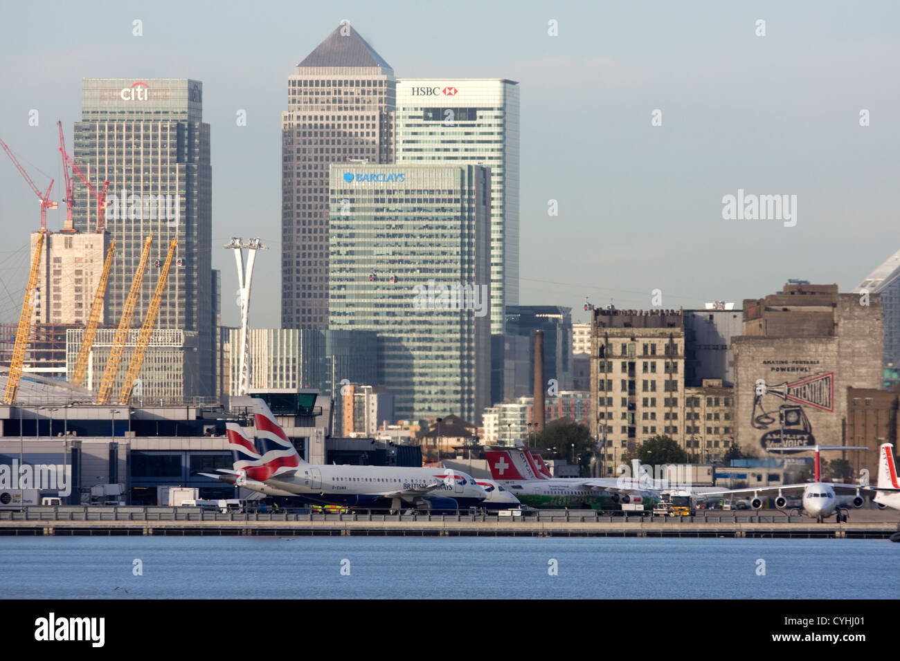 Regional airliners at London City Airport. Canary Wharf and O2 in the background, England, UK Stock Photo