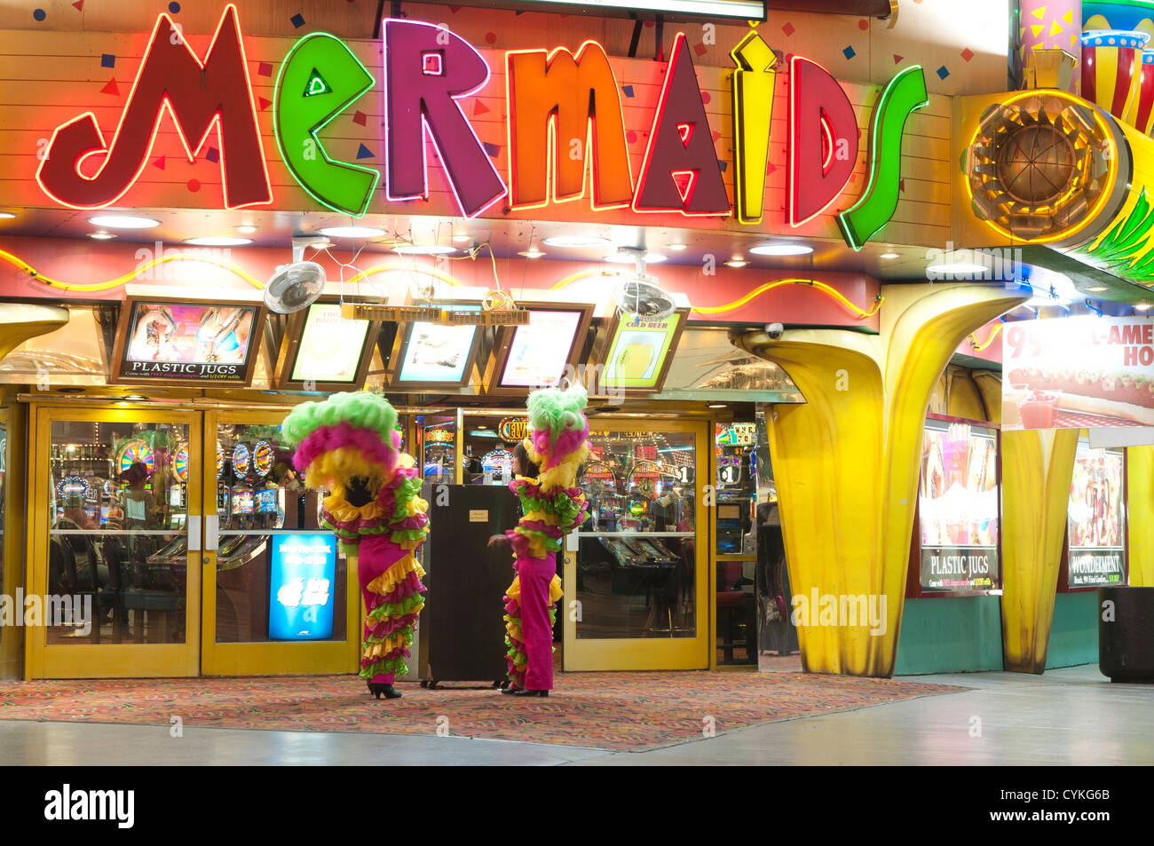 Showgirls In Feathers Outside Mermaids Casino Nighttime At The Stock Photo