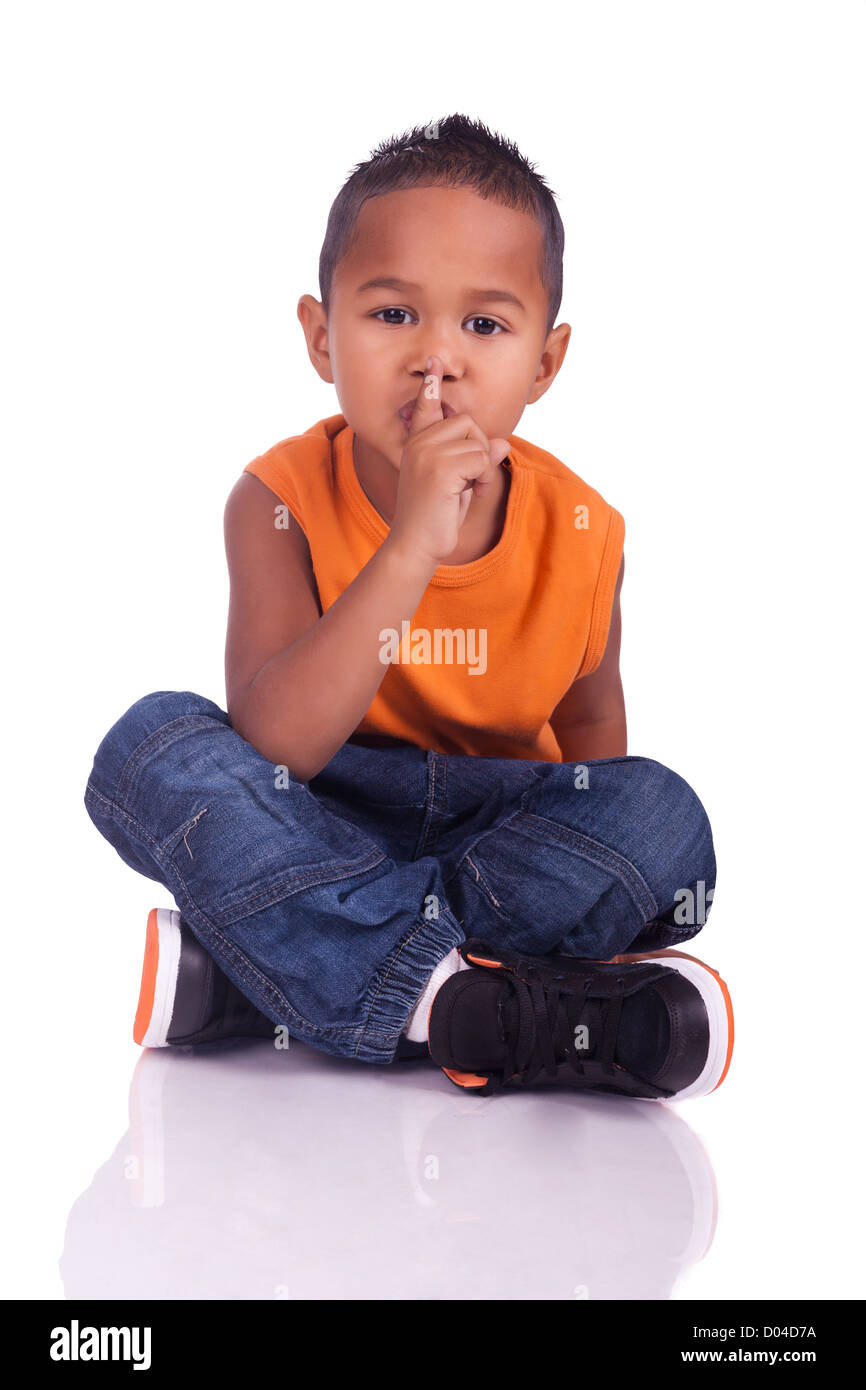 A portrait of a cute asian boy seated on the floor Stock Photo