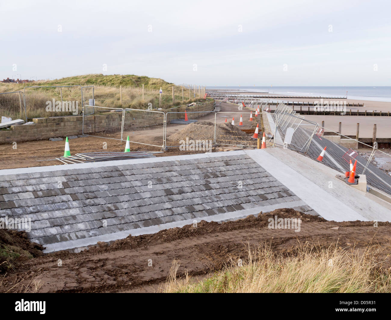 Granite Block Seawall : Construction of a new sea wall in front sand dunes at