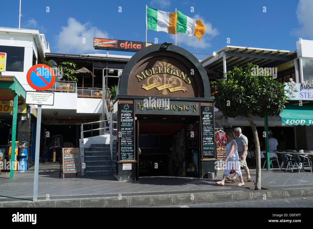 Dh puerto del carmen lanzarote tourist walking passed irish stock photo royalty free image - Lanzarote walks from puerto del carmen ...