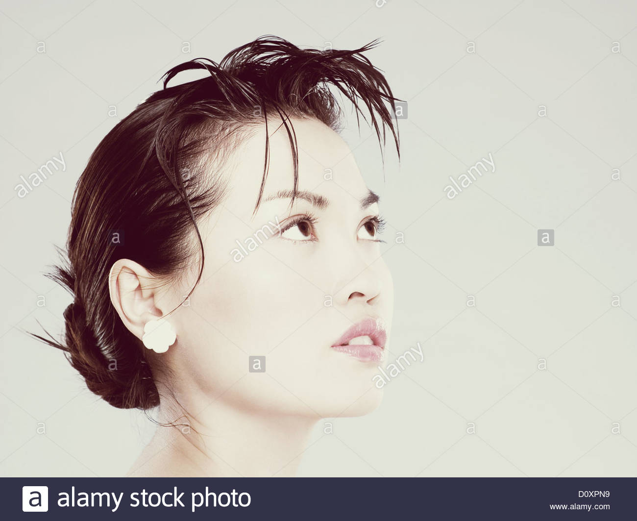 Young woman looking up Stock Foto