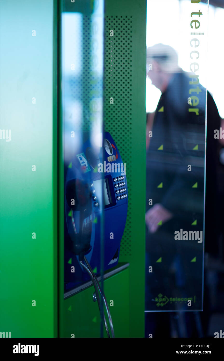Telephone box in International airport with man in the distance Stock Foto