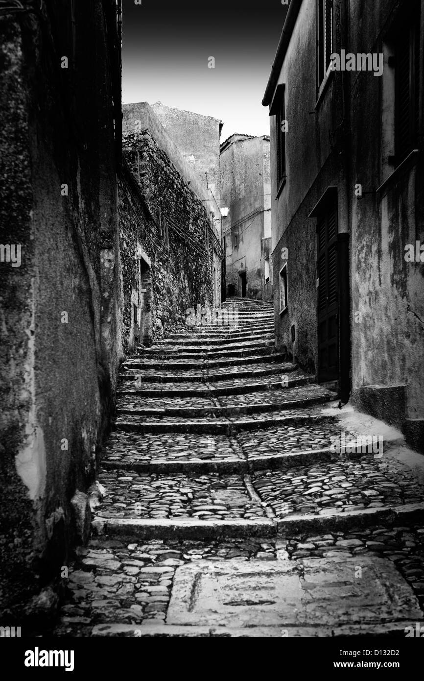 Narrow cobblestone stairs illuminated by moonlight Stock Foto