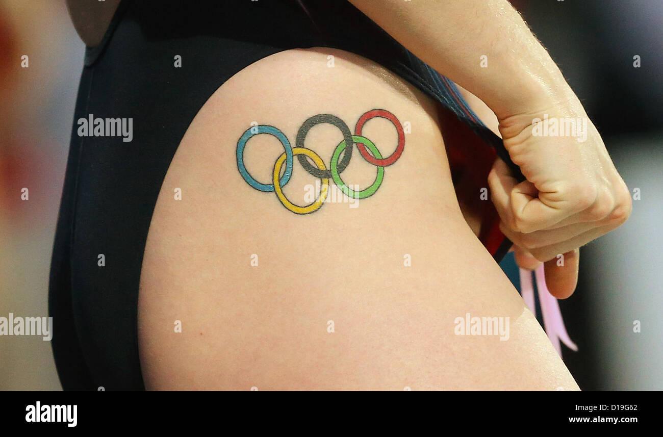 Тату олимпийских колец фото