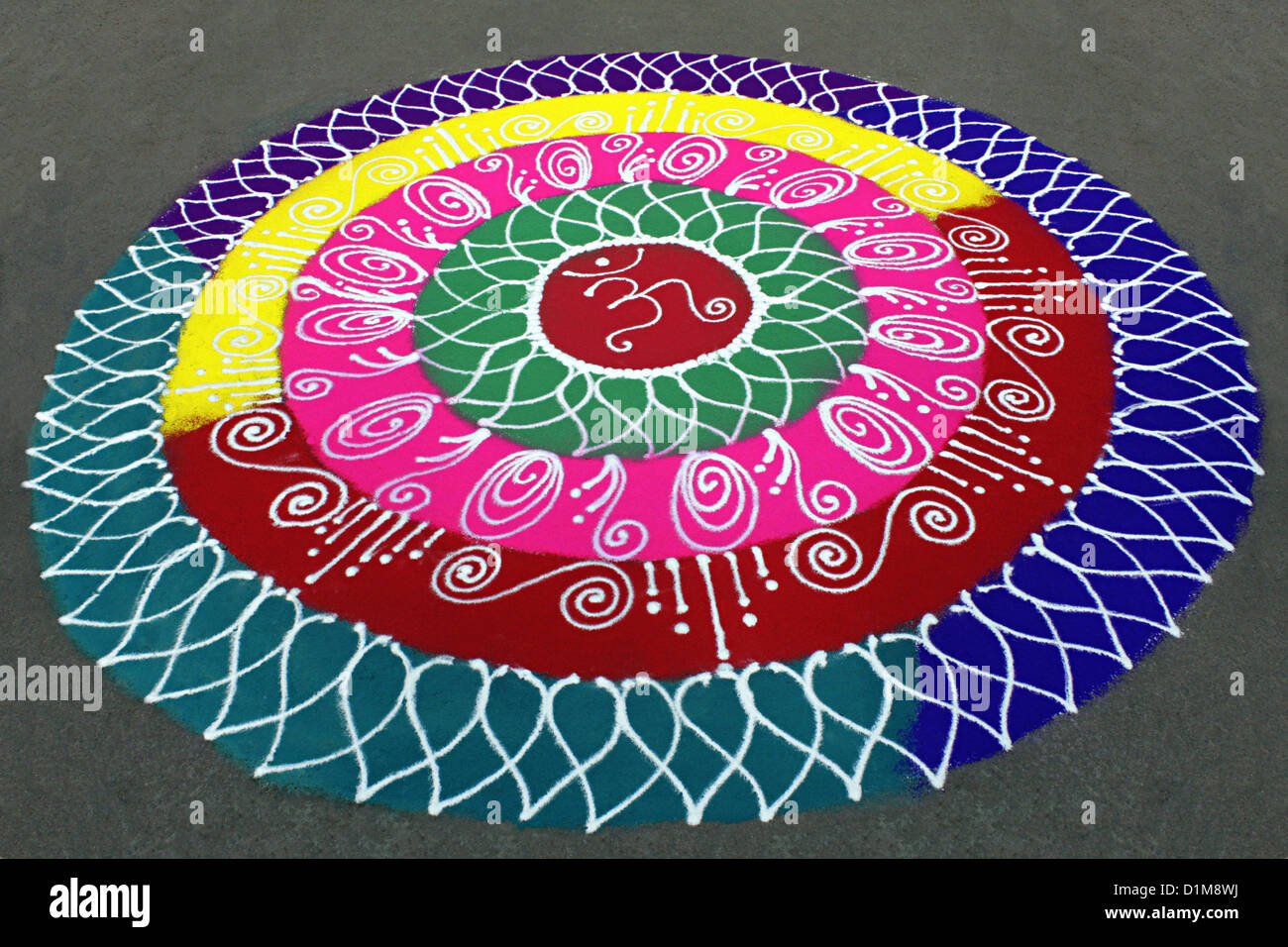 Colorful rangoli circular designs on the floor during for Floor rangoli design
