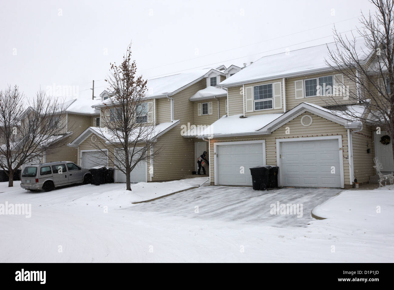 Snow falling in residential street during winter saskatoon for Drummond designs canada