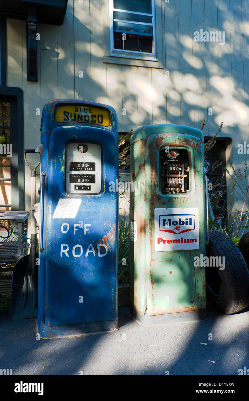 Pair Of Vintage Gas Pumps For Sale Outside An Antique