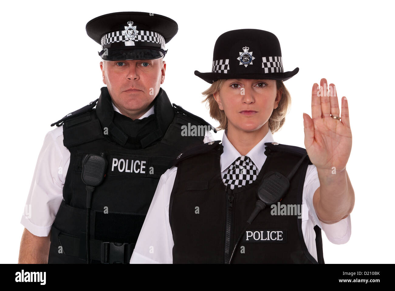 studio shot of male and female british police officers in