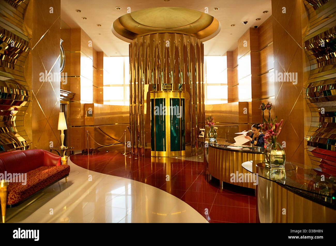The gold interior reception and elevator area of the seven for Dubai hotels 7 star interior