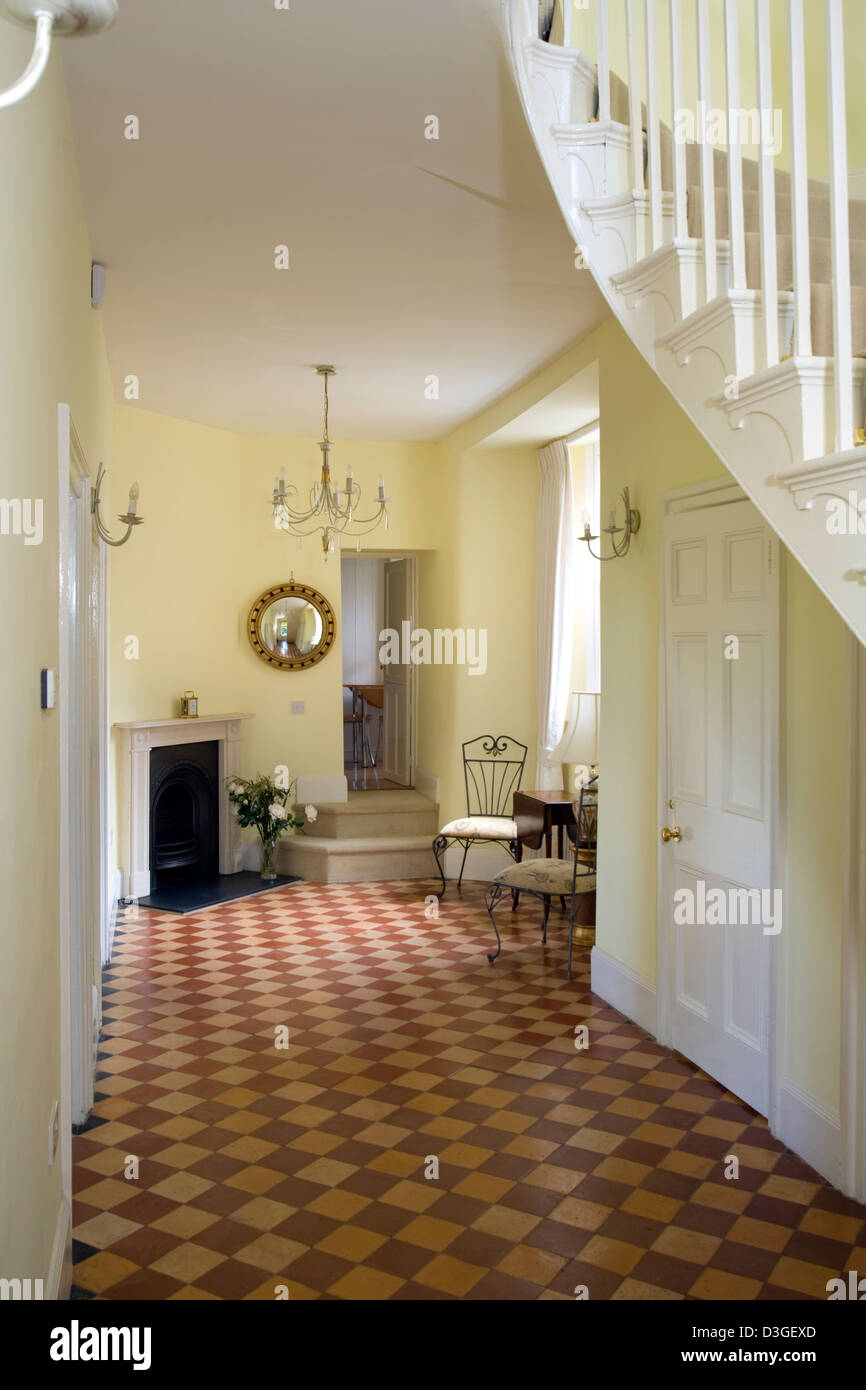 A Large Victorian Style Hallway With Chequer Board Pattern