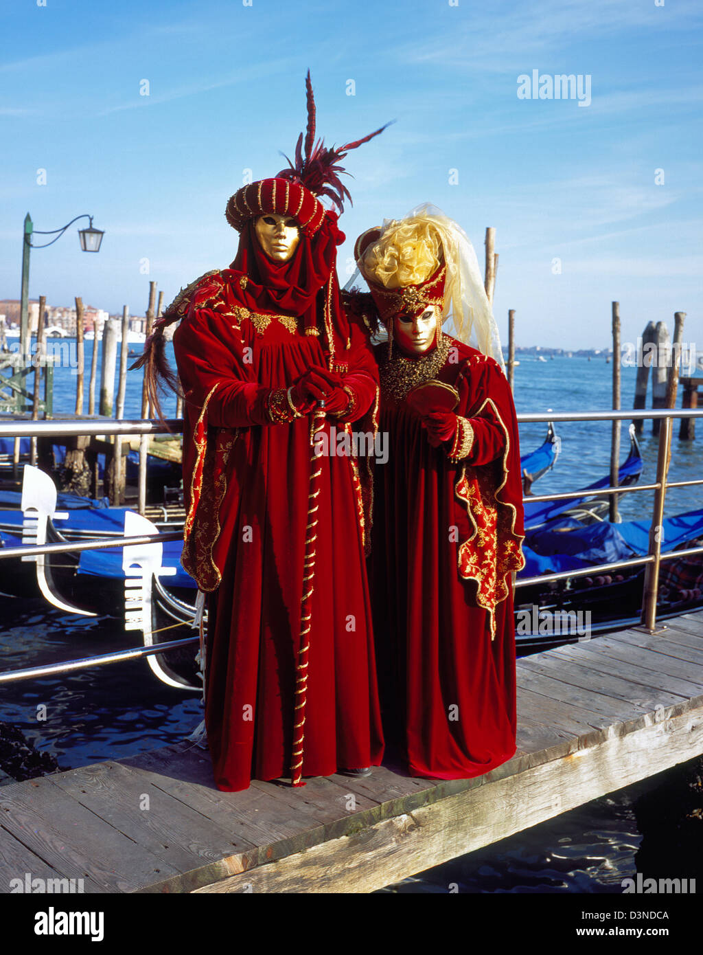 Two masks dressed up in historical costumes pose on a footbridge in Venice, Italy, 01 February 2006. Photo: Willy Stock Photo