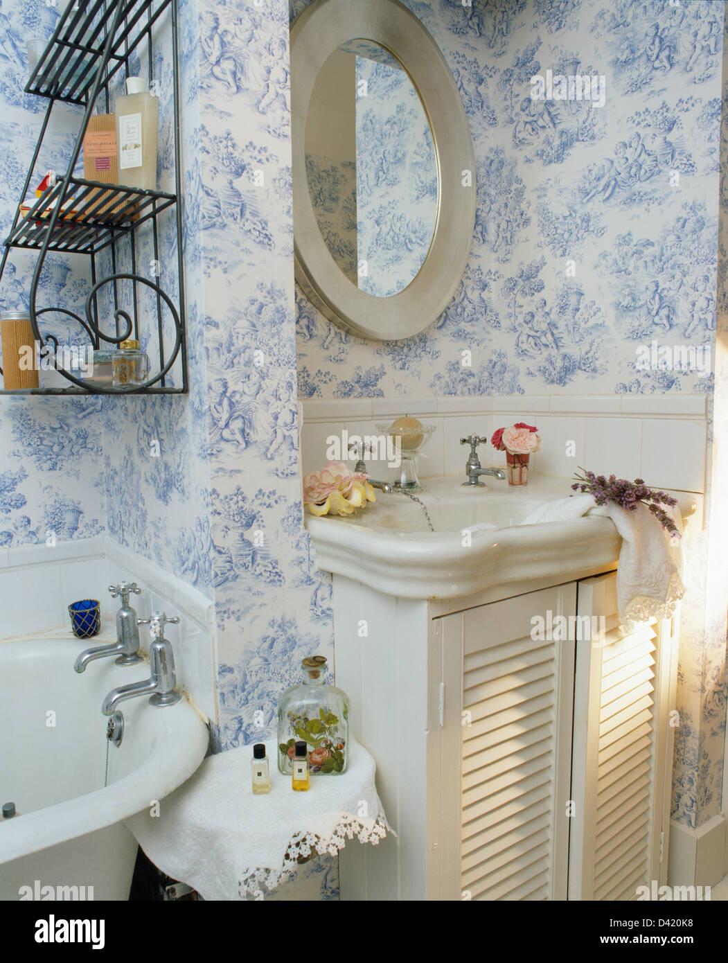 Vintage washbasin in vanity unit with louvred doors in for Vintage bathroom wallpaper