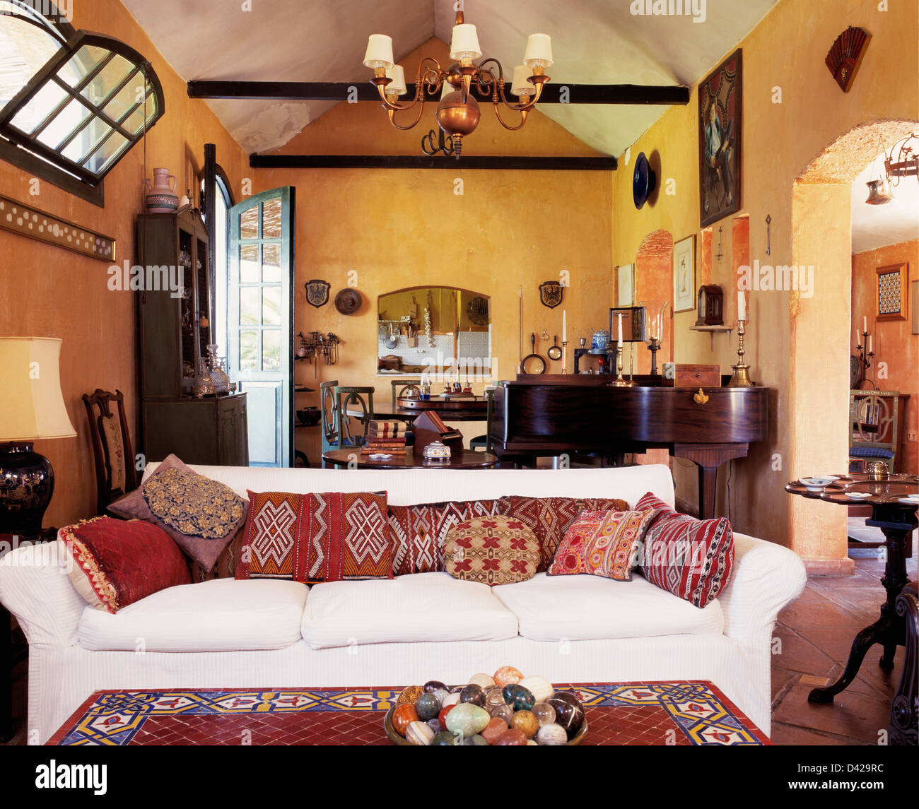 White Sofa With Patterned Cushions In Yellow Spanish Living Room With Stock Photo Royalty Free